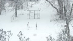 Beautiful snowfall on the background of the broken and not well-kept yard Stock Footage