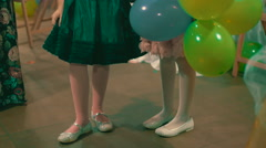 Two little girls with air  baloons dancing Stock Footage