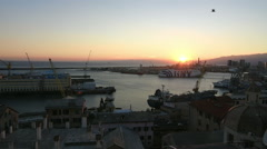 A view of the port of Genoa at sunset Stock Footage