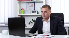 Businessman nervously talking to clients on the web camera Stock Footage