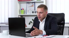 Businessman angry and nervous to talk on webcam Stock Footage