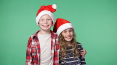 Couple of children in christmas caps Stock Footage