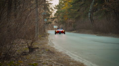 Red sport car moving toward camera Stock Footage