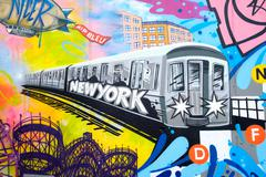 Colorful graffiti in New York City with an image of a subway tra Stock Photos