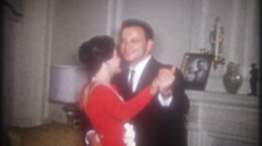 Well dressed husband & wife dance together at home, 3720 vintage film home movie Stock Footage