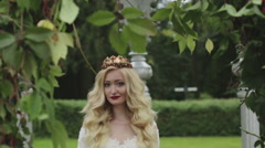 Blonde bride with long curly hair in the crown is smiling and laughing. Stock Footage