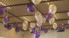 Colorful balloons floating on the ceiling indoors Arkistovideo