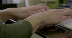 Pan right of female hands typing on keyboard Stock Footage