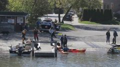Boaters and Kayakers at boat ramp Stock Footage