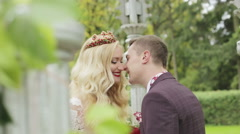 Close-up. Newlyweds are looking at each other with love and kissing. Stock Footage