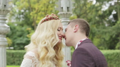 Close-up. Just married are looking at each other with love and kissing. Stock Footage