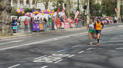 4K Visually impaired runner competing in the 2016 London Marathon - Editorial Stock Footage