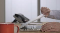 Male hands with wedding ring opening lap top, begins typing Stock Footage