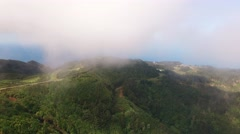 Flying in clouds over mountains and forest of Madeira, Portugal aerial view Stock Footage