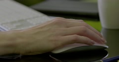 Female hand using mouse moves to keyboard Stock Footage
