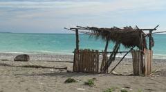 Fisherman hut on seashore Stock Footage