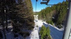 Aerial ski lift transportation system which skiers transport while suspended off Stock Footage