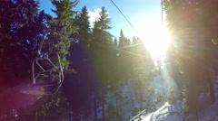 Aerial ski lift climbs up towards the sun light to Snezhanka Peak at Pamporovo Stock Footage
