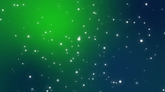 Sparkly white light particles moving across teal green gradient background Stock Footage