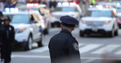 Police officer cop and police cars Stock Footage