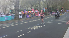 4K Runner in the 2016 London Marathon being cheered on by the crowd - Editorial Stock Footage