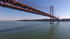 Suspension bridge 25 de abril over the tagus river in lisbon, aerial shot 4k Stock Footage