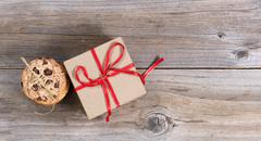 Baked cookies and a holiday gift on rustic wooden boards Stock Photos