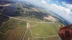Professional parachute jumper flying above green fields. Extreme. Landing Stock Footage