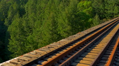 4K Train Trestle Bridge, Steel Rails and Wooden Structure, Forest Background Stock Footage