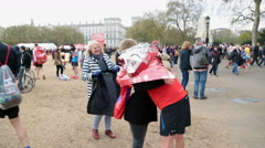 Exhausted runner in London Marathon embraces family at end of race - Editorial Stock Footage