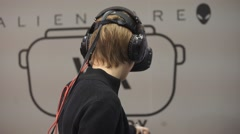 Boy playing video game with HTC Vive VR glasses Stock Footage
