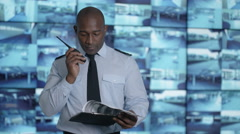 4K Portrait smiling security officer in system control room Stock Footage