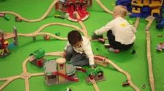 Boys playing rail road in shopping mall Stock Footage
