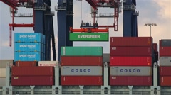 Loading containers on a ship Stock Footage