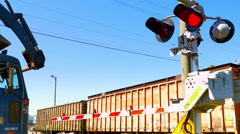 4K Train Crossing Past Road Traffic, Train Crossing Sign, Road Redlight Signal Stock Footage