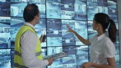 4K Portrait smiling security officers in system control room Stock Footage