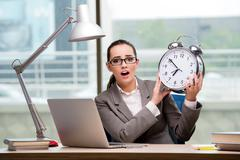 Businesswoman failing to meet challenging deadlines Stock Photos