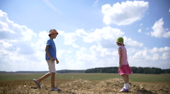 Boy gives a girl a flower in a field girl glad gift of flower, love concept Stock Footage