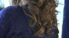 Professional hairdresser doing curles for beautiful woman Stock Footage