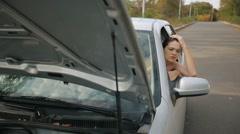 Sad Woman in broken car Stock Footage