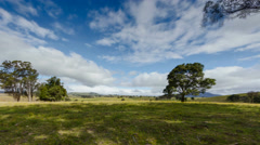 Timelapse clouds over rolling hills Australian coutryside Stock Footage