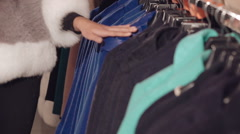 Close up of stylish lady choosing the coat in boutique Stock Footage