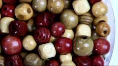 Top view of rotating colorful crafting beads Stock Footage