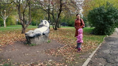 Mother and daughter walking in the autumn park. Stock Footage