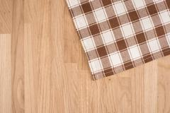 Checkered Tablecloth On The Wooden Background Stock Photos
