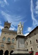 Statue of Liberty in San Marino Country and the ancient palace called Palazzo Stock Photos