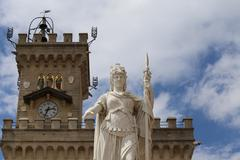 Marble Statue of Liberty in San Marino Microstate and the tower Stock Photos