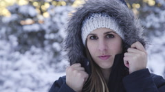 Surrounded by Snow, A Women Looks Forward with Intrigue Stock Footage