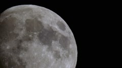 Nearly full moon moving slowly in the sky pitch black of night 3 Stock Footage