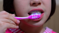 Young girl with toothbrush wash your teeth before you go to school 02 Stock Footage